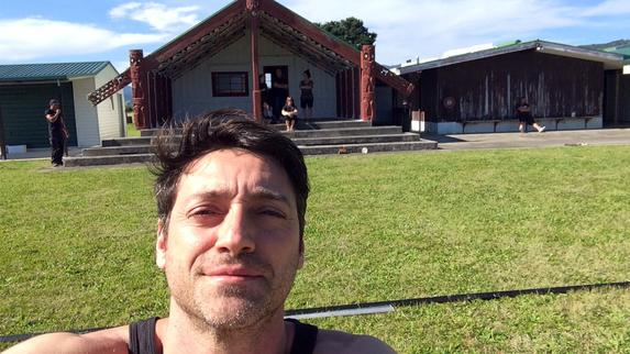 Euripides in front of the Morai (the house of the Maori community) where the workshop and the rehearsals took place.